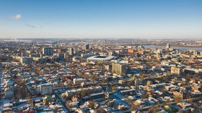 Urban bird`s eye view of Dnipro city skyline. Winter cityscape background. royalty free stock images