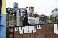 Urban Blight. Graffiti on the rooftops of New York City buildings royalty free stock image