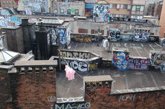 Urban Blight with Laundry. New Yorkers dry their laundry on the roof amid graffiti Royalty Free Stock Images