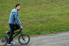Urban bmx rider. On the grass Stock Images