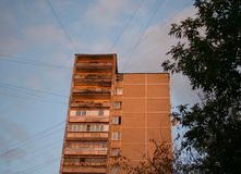 Urban brick building with wires in the sunset stock image