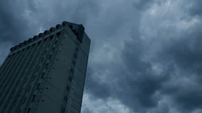 The urban building at the storming clouds