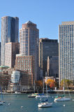 Urban buildings and sailing boats in Boston Harbor Stock Image