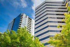 Urban buildings under blue sky. Condominium and Office building under blue sky Royalty Free Stock Image