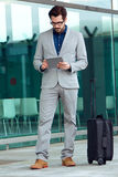 Urban business man with laptop outside in airport Stock Image