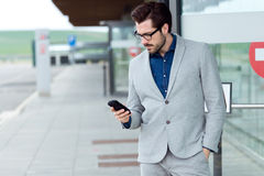 Urban business man using smartphone Royalty Free Stock Images
