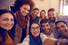 Urban business team together in office. Selfie of urban business team together in office Stock Photo