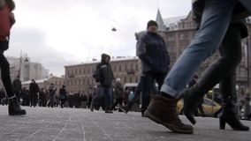Urban bustle. Hurrying people in the streets of St. Petersburg winter Camera in motion  Time Lapse stock video