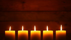 Urban Candles on Vintage Ship Wood Background. This is a video of five candles with flames at the bottom of the frame. They are blown out at the end stock video footage