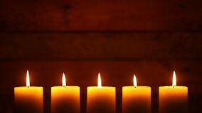 Urban Candles on Vintage Ship Wood Background. This is a video of five candles with flames at the bottom of the frame. There is lots of space for copy on a blank stock footage