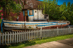 Urban Castaway. An old boat moored on land Royalty Free Stock Image