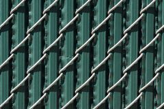 Urban Chain Link Closeup Abstract Texture Background. Chain link fence closeup abstract texture background with urban city background Royalty Free Stock Image