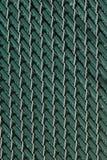 Urban Chain Link Closeup Abstract Texture Background. Chain link fence closeup abstract texture background with urban city skyline background Stock Photo