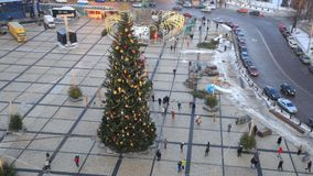 Urban Christmas Tree in Kiev, Ukraine. Trees decorate a city center. People are walking around and making selfie stock footage
