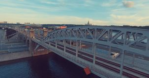 Urban city aerial view. Beautiful Aerial view of Luzhnetsky metro bridge. Flying over heavy traffic in the evening, top view of Moscow river and urban city stock video footage
