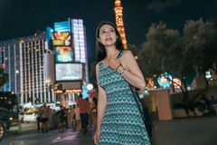 City Asian girl walking on street at night stock photography