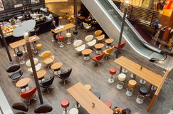 Urban city cafe inside the moderm shopping mall with customers Royalty Free Stock Photo