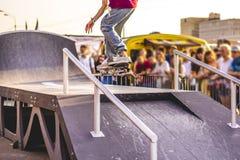 Urban city man doing extreme skate tricks on ramp royalty free stock photos