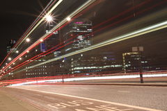 Urban city night shot on London Bridge, Red Bus in Motion, long exposure shot Stock Photography