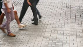 Urban city pavement, people walk on tiles, business suits casual. Stock footage stock video