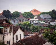 An urban city places of building houses mountain at jogja yogyakarta indonesia. Java Royalty Free Stock Image