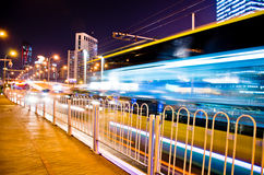 Urban city road with car light trails. Stock Photos