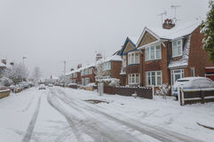 Urban city road with snow and ice Stock Photography