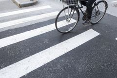 New york city crosswalk with a biker peddling his bicycle stock photos
