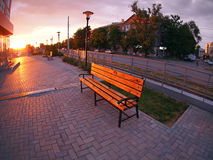 Urban cityscape with benches and lanterns in the evening Royalty Free Stock Photography
