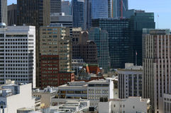 Urban cityscape scene with tightly packed buildings and skyscrapers in San Francisco a city located on the ring of fire with a his Royalty Free Stock Images