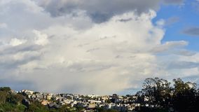 Urban Clouds. Timelapse of storm clouds moving over Presidio Heights in northwest San Francisco.  Wide angle shot, late afternoon sun.  Looking east from just stock video footage