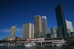 Circular Quay cityscape, Sydney Harbor. City waterfront. Iconic skyline of downtown skyscrapers. Ferries in water. CBD coastline. Urban coast with modern high stock photo