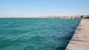 Urban coast, sea with few waves and the city of Thessaloniki in the background, Greece