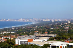 Urban Coastal Landscape Against Blue Durban City Skyline. Above view of  commercial and residential buildings urban coastal landscape against blue Durban city Stock Photography