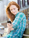 Urban Communication - Woman Texting Stock Images
