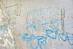 Urban Concrete Graffiti Wall With Peeled Paint And Ripped Ads Stock Photography