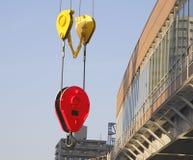 Urban construction. Crane hook between modern buildings in a city Stock Photo