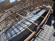 Urban construction site. With metal reinforcement, focus on foreground with wide angle fisheye view royalty free stock photo