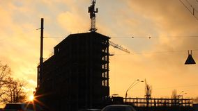 Urban construction sunset silhouette stock video
