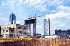 Urban construction zone. Cranes towering over a high rise construction project in a busy work zone downtown in fast growing Austin, the capital city of Texas Royalty Free Stock Images