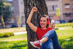 Urban cool girl listening to music outdoor royalty free stock image