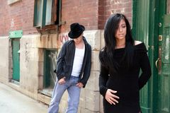 Urban couple. Young urban fashion couple in the city street royalty free stock image
