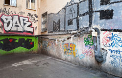 Urban courtyard with colorful abstract graffiti Royalty Free Stock Photography