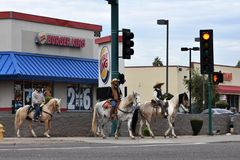 Urban cowboys riding in front of a Burger King. stock photography