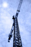 Urban Crane. With dramatic blue sky in background stock photos