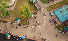 Urban crowd from above. Crowd, Public Park, Summer, Swimming Pool, Walking, many people are walking stock images