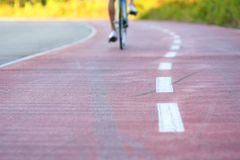 Cycling concept, low angle view road from behind royalty free stock photography