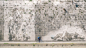 Urban cyclist riding on cycle lane alongside of Tevere River, Rome Italy. Rome Italy, April 2017: Urban cyclist riding on cycle lane alongside of Tevere River in Stock Images
