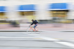 Urban cyclist riding at speed Stock Image