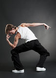 Urban dancer in white T-shirt. Posing over dark background Stock Photography